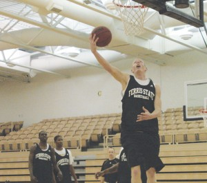 Reach for the Sky: Senior Austin Randel polishes up his slam dunk style at practice. The season opening game took place this Sunday in Illinois, ending with a close 65-60 loss to the Lewis Flyers.  Photo By: Kate Dupon   Photographer