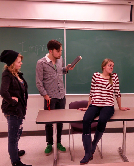 Devin Anderson (middle) and Jenna Matelske (right) host an evening of improv comedy as part of the group set up by theater fraternity Alpha Psi Omega. Improv's comedy shows are open to all students every Sunday night at 7p.m. in Starr 138. Photo By: Tyler Hanan | Lifestyles Editor