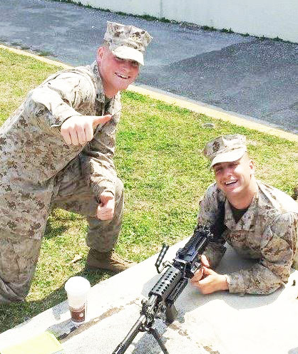 Joel Lloyd (right) and a fellow Marine during training. Lloyd is now a student in the welding engineering technology program.